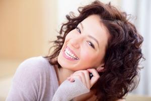 Surya Brasil woman laughing with dark red hair-2
